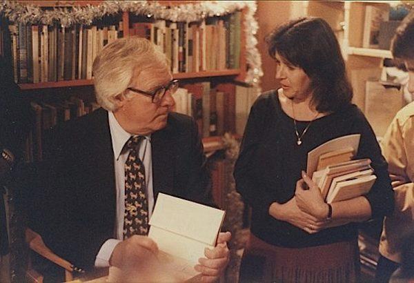Author Ray Bradbury signs books alongside Lorraine Zimmerman, owner of Fahrenheit 451 Books in Laguna Beach, on Dec. 12, 1982.
