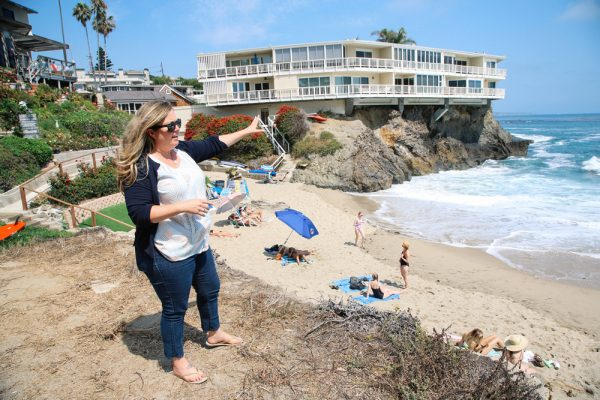 Sara Lowell surveys Fisherman's Cove, likely to be impacted by the rising seas of a warming climate. She wants Laguna Beach to support the Paris accords on climate change.