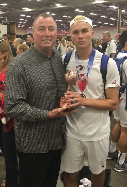 Barry Greenough with his dad Jeff and the third place trophy won by the Manhattan Beach squad. Barry's team lost to Balboa Bay in the semifinals.