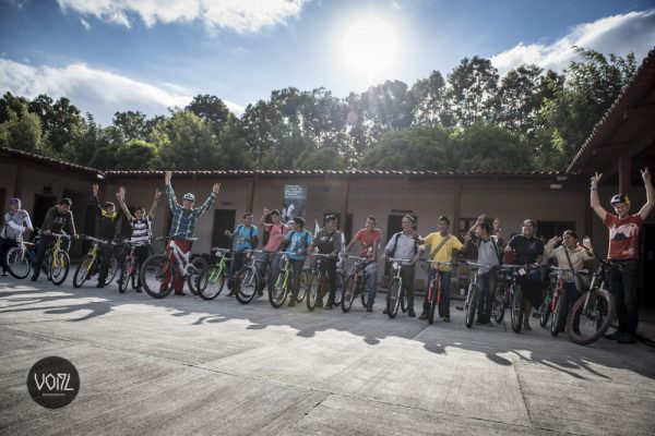Mountain bike champion Hans Rey, left, donates bikes in Guatemala.