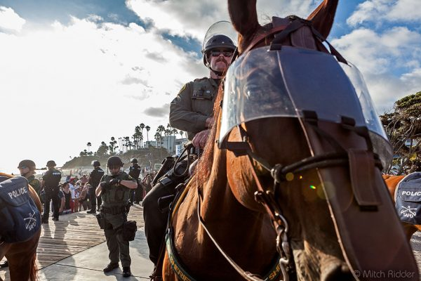 Mounted police proved an invaluable resource for crowd control during a largely peaceful political demonstration that at its peak drew 2,500 people to Main Beach on Sunday, Aug. 20. Photo by Mitch Ridder