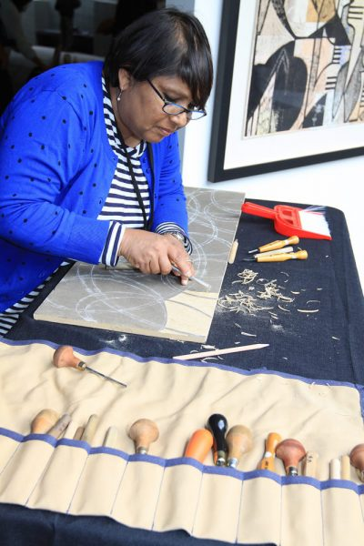 Printmaker Vinita Voogd at work on a project.