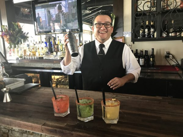 Omar Muratalia of Carmelita's shakes up fresh-fruit cocktails.