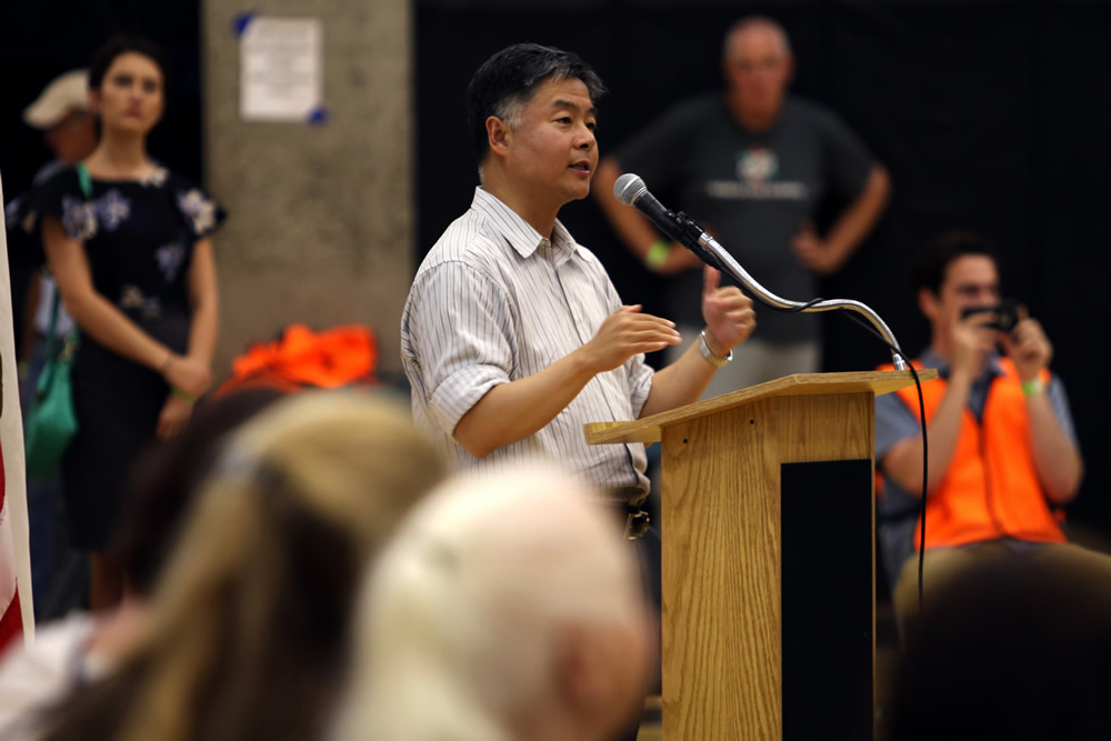 Rep. Ted Lieu of Torrance fields questions at a town hall meeting organized by activists. Photo by Walter Hammerwold