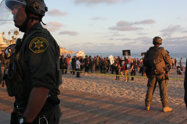 Police maintaining civility on Main Beach Sunday during a demonstration.