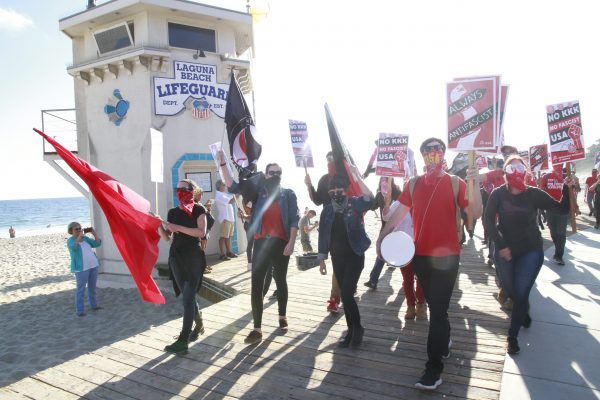 The Democratic Socialists of America  carried anti-fascist symbols. Photo by Joe Melita