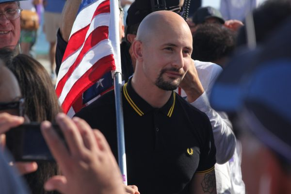 Johnny Benitez amid supporters at the America First rally on Aug. 20.
