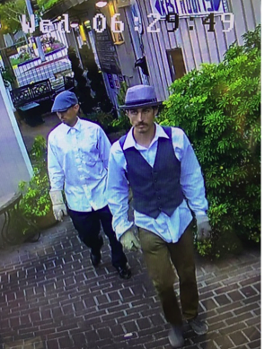 An image from a surveillance video of suspected jewelry thieves.