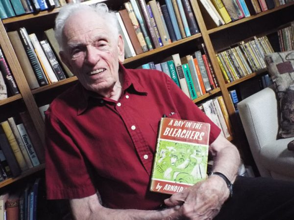 Arnold Hano with one of the books he's written on baseball