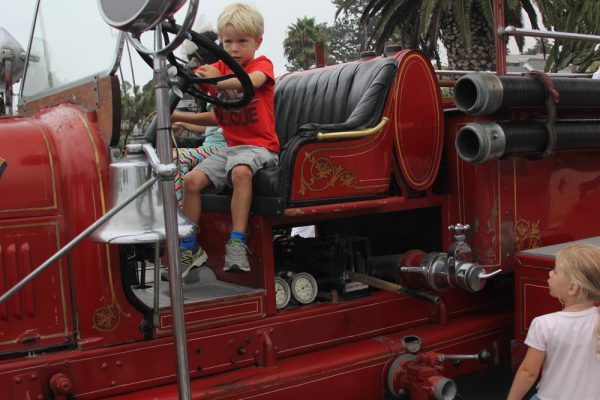 El Morro kindergartner Caleb Cornell, 5, seizes the wheel of the antique fire engine on  display for the fundraiser breakfast.