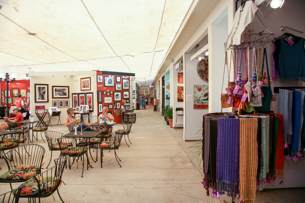 Summer attendance proved thin at Art-a-Fair, though some artists still experienced strong sales.  Photo by Jody Tiongco