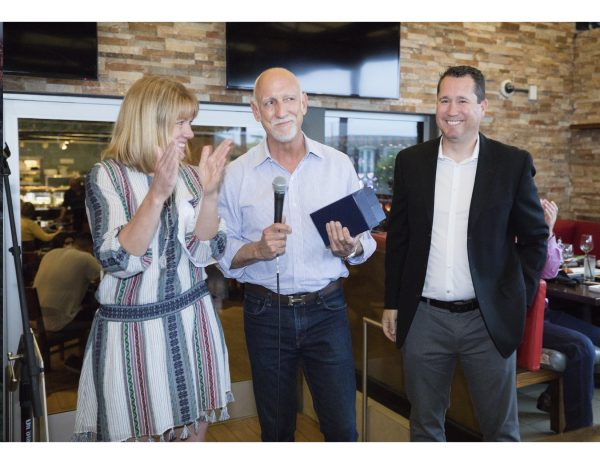 From left: Hall of Fame Award recipient and Laguna Beach parent Brent Martini, center, earns the applause of SchoolPower Executive Director Robin Rounaghi and Superintendent Jason Viloria. Photo by Kristin karkoska