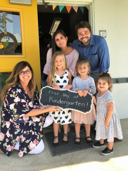 Mary Blanton welcomes former student, Alex Wilson, and his wife and daughters. Wilson's oldest daughter, McKay, is now a member of Mrs. Blanton's class.