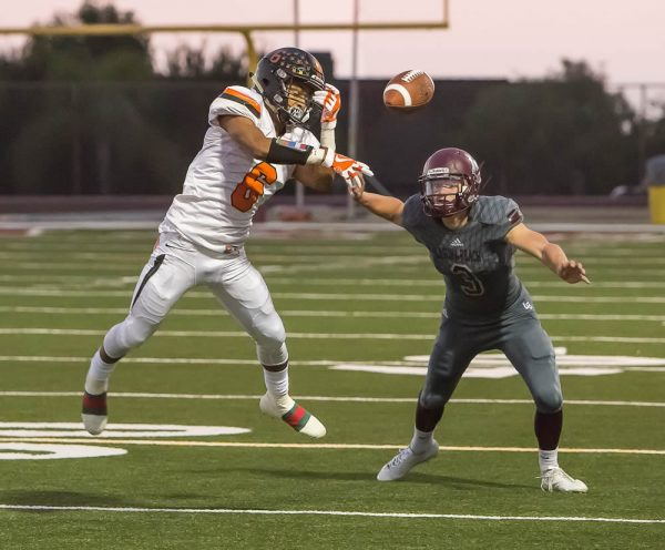 Curtis Harrison broke up and nearly intercepted this Jason Wilkinson pass attempt to Jordon Schmidt. Harrison accounted for 83 yards rushing and passed for 202 yards.  Harrison completed 12 passes on 31 attempts with two touchdowns and three interceptions. Photo by Doug Landrum.