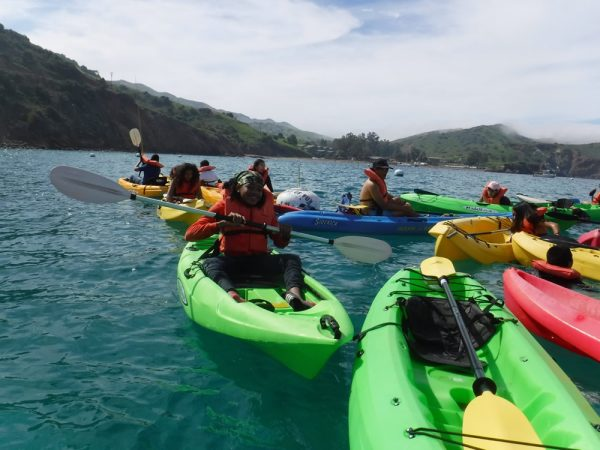 Middle-school students from Pasadena's Washington STEAM Magnet Academy kick their fear and unfamiliarity with the ocean and kayak for the first time at an ocean-awareness camp last March on Catalina Island, thanks to contributions from OAC. Photo by Susan Campbell.
