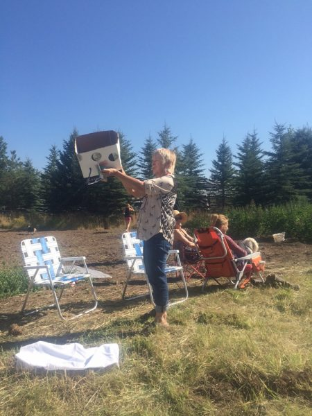 Laguna Beach resident Patti Oshlund prepares a cardboard contraption last week to view the solar eclipse during a visit to Wyoming, where the moon briefly fully enveloped the sun.
