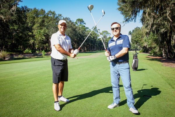 Ment'or founders JÈrÙme Bocuse and Daniel Boulud teeing off at the 2016 Robb Report Culinary Masters Golf Tournament (PRNewsfoto/Robb Report)