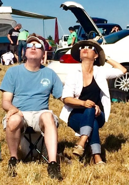Darren and Jinhee Trone take in the eclipse last Monday, Aug. 21, on an Oregon farm.