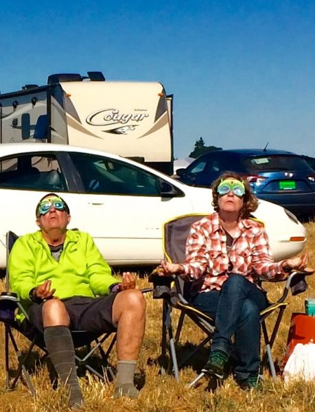 John Dombrink and Maya Dunne join others from Laguna Beach for the solar eclipse at a farm in Oregon, in the path of totality.