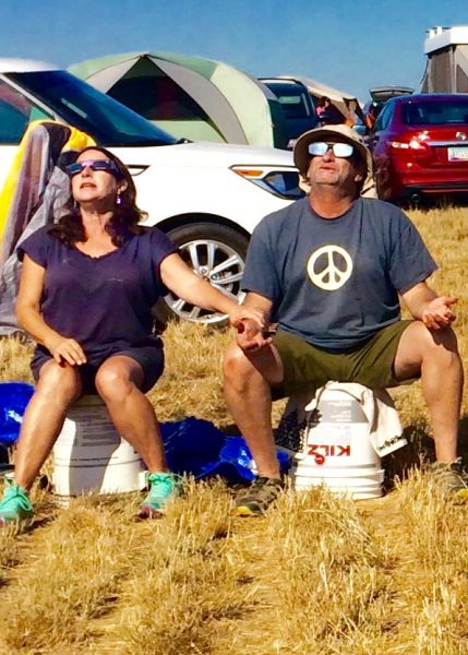 Ellen Girardeau Kempler and Roger Kempler in a moment of om leading up to the minute of totality at Wooden Shoe Tulip Farm in Woodburn, Ore. Photos courtesy of Ellen Kempler.
