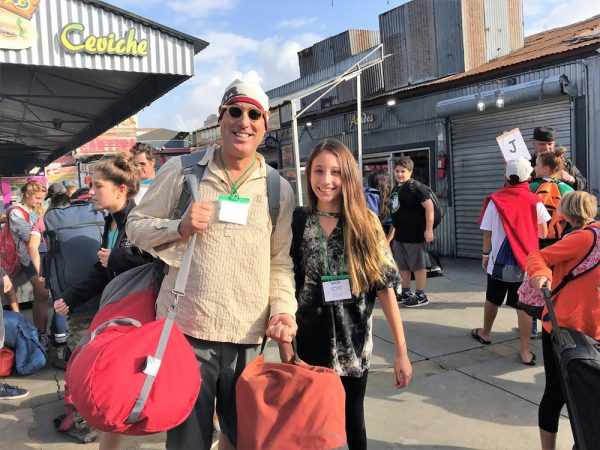 Science teacher Richard Selin and Shaylee Garrett grab bags and get ready to board.