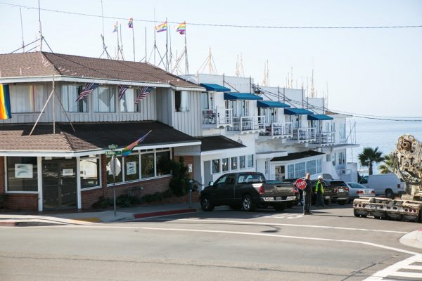 The Coast Inn with story poles showing proposed renovations.