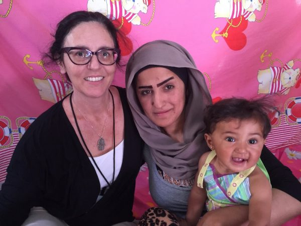 Jackie Menter, left, on the island of Chios in Greece last July, where she brought aid to Syrian refugees.