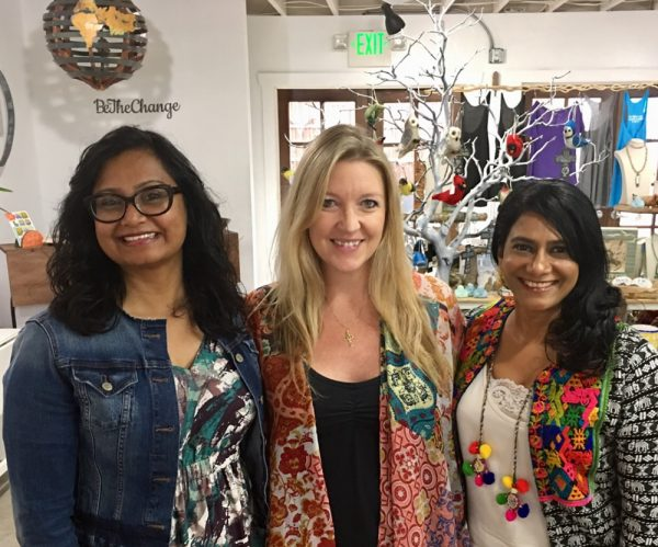 Katie Bond, center, of Peace Exchange, flanked by Kavita and Vidya Reddy of Buy Hand ring in the holiday spirit with a party for its patrons. Photos by James Gallen