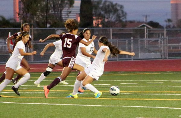 Reilyn Turner, center, on her way to scoring for LBHS after receiving a pass from her sister, Blake, upper left, during the Breakers' 2017 soccer season.
