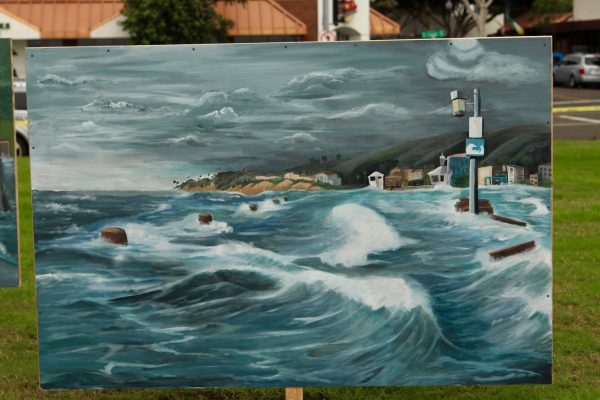 One of three student-painted murals depicting the fate of downtown Laguna Beach due to sea level rise installed last week at Main Beach. Photos by Bridget Beaudry-Porter.