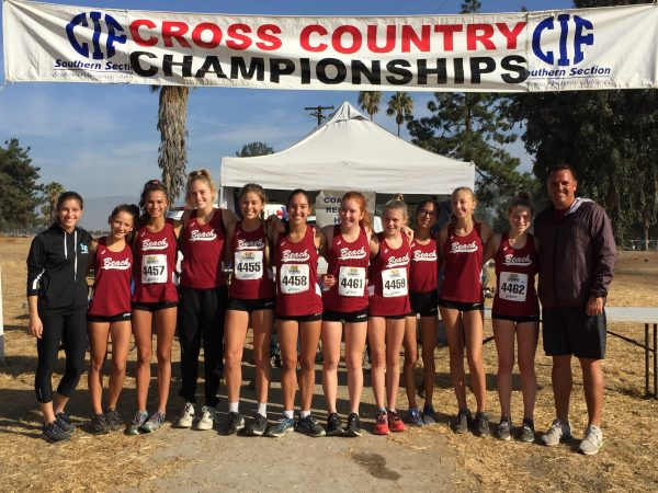 From left, Coach Aliya Shaw, Audrey Sutton, Jessie Rose, Evie Cant, Grace LaMontagne, Kaitlyn Ryan, Hannah Vogel, Sydney Shaefgen, Angelina Dyrnaes, Sierra Read, Whitney Winefordner and head coach Steve Lalim. Photo courtesy of girls cross country.