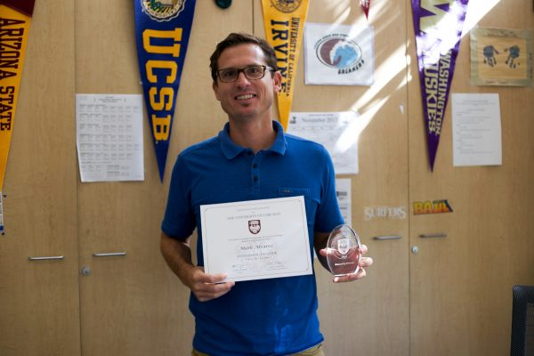 A university recognizes government and economics teacher Mark Alvarez with an award. Photo courtesy of LBUSD.