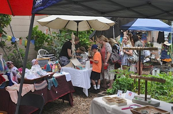 An earlier arts and crafts show in June at the community garden.