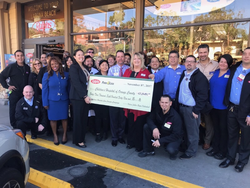The remodeled Ralph's market was dedicated with a gift to Children's Hospital Orange County. Company executive Myeisha Gamino, third from left, presented the check to CHOC's Winnie Tran, fourth from left.
