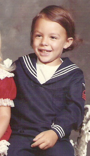 Shea Ackerly in sailor suit his Brotherhood father, Bobby, had made for him