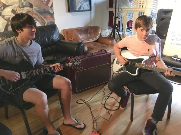 "– Max Fruman and Wyatt Beckley practice ""One Big Tree,"" an original song they and five other teens composed together."