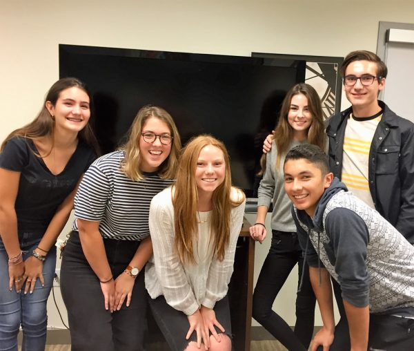 From left, students Laura Bianchi, Cash Strauss, Tia Mills, Izzy Lazur, Charlie Dickerson and Fernando Barraza (front) enjoy sharing their knowledge of technology with seniors.