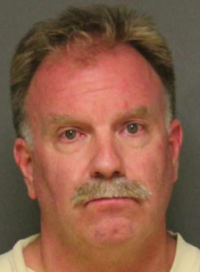 Laguna Beach police Officer Rock Wagner was placed on administrative leave after his arrest on suspicion of elder abuse and fraud.