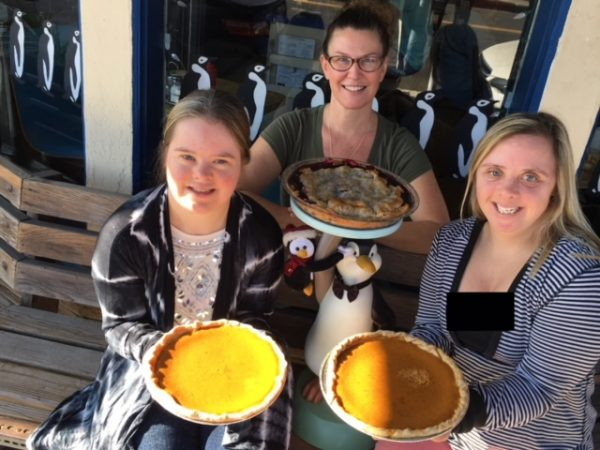 Sabrina McMurray, center, with residents of Glennwood House, is contributing a slice of this month's pie sales to the facility.