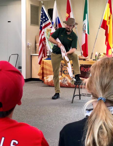 Presenter Philip Black re-enacts the Bear Flag Revolt in a fourth-grade TOW class.