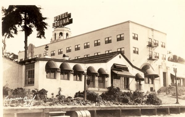 Boardwalk restaurant Café Los Ondas, in the foreground, and Hotel Laguna, including a neon sign that once topped its bell tower. The beacon to travelers was removed during the blackouts of World War II and a 1966 sign ordinance doomed it.