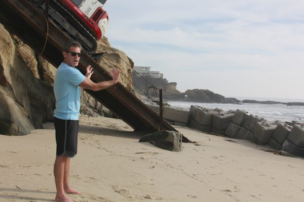 Waterman James Pribram questions the value of a temporary sea wall below the Agate Street beach access project.