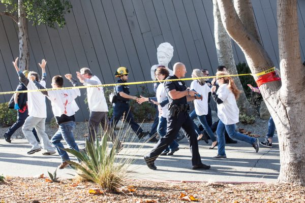 Civilians posing as casualties added realism to a law enforcement active-shooter training drill this past Wednesday at the Laguna College of Art and Design. Photo by Dondee Quincena.