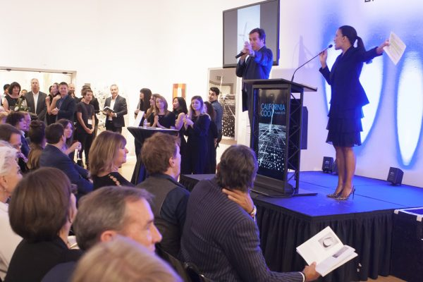 Art lovers pack Laguna Art Museum to bid on arts works at an auction that support museum programs.