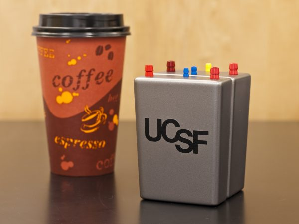 The artificial kidney is less than the size of a coffee cup. Photo courtesy of the author.