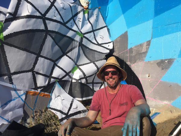 "Muralist Jeff Lavinsky during installation of ""Main Beach Mandala,"" located south of Main Beach.Photo courtesy of Jeff Lavinsky"