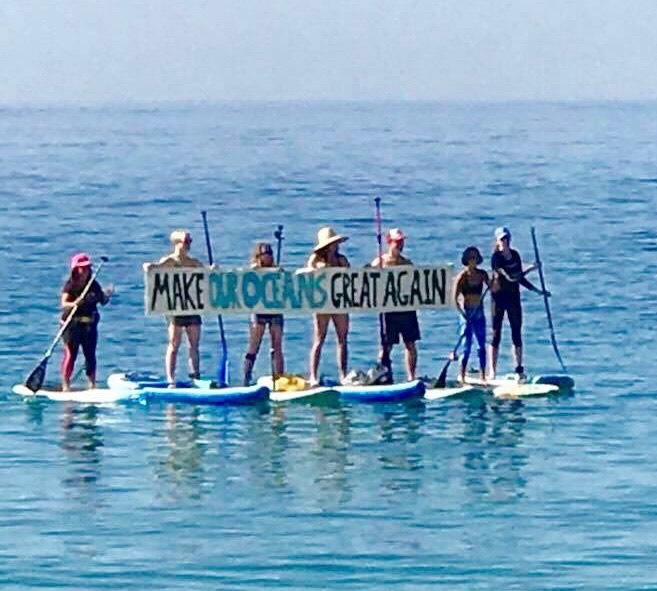 Calm seas allowed paddle boarders to make their point. Photo by Heidi Miller.