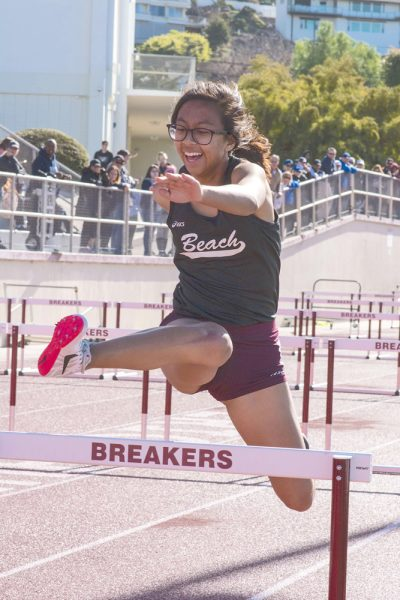: LBHS freshman Amber Goh competes in the 100-meter hurdle and finished with a time of 24.03. The winning time was 17.52.