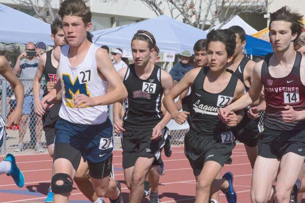 Freshman Will Compton, No. 22, competes in the 1,600-meter race and finished at 5:08.70. The winning time was 4:31.76.