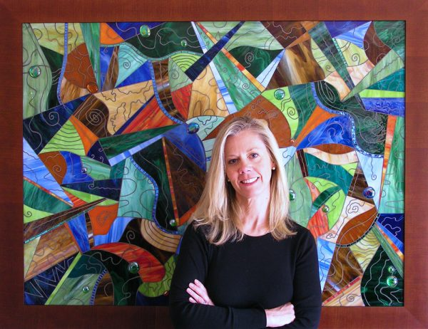 Artist Margaret Willmoth Jensen and an example of her work.